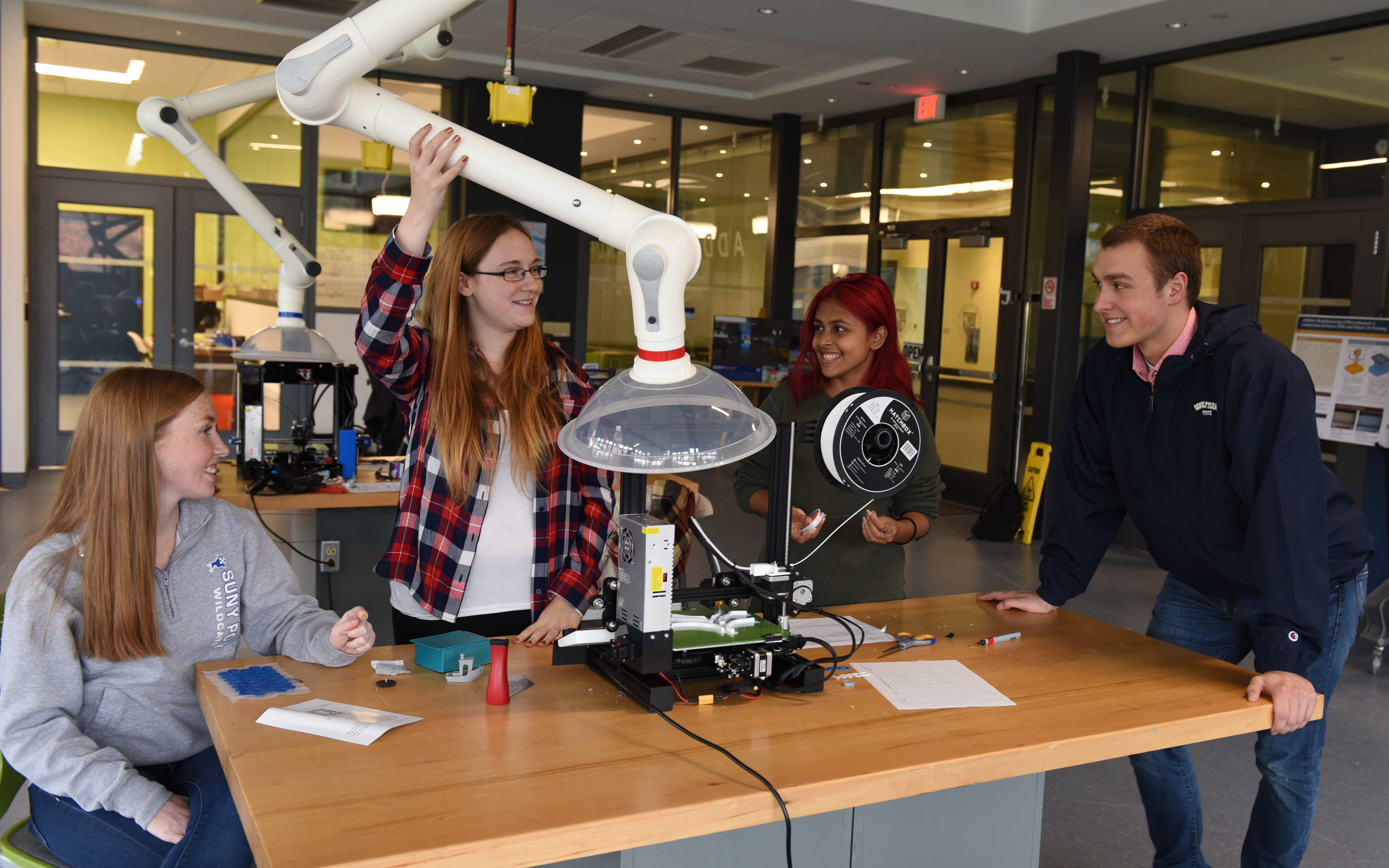 Four SUNY Poly students in the CGAM lab