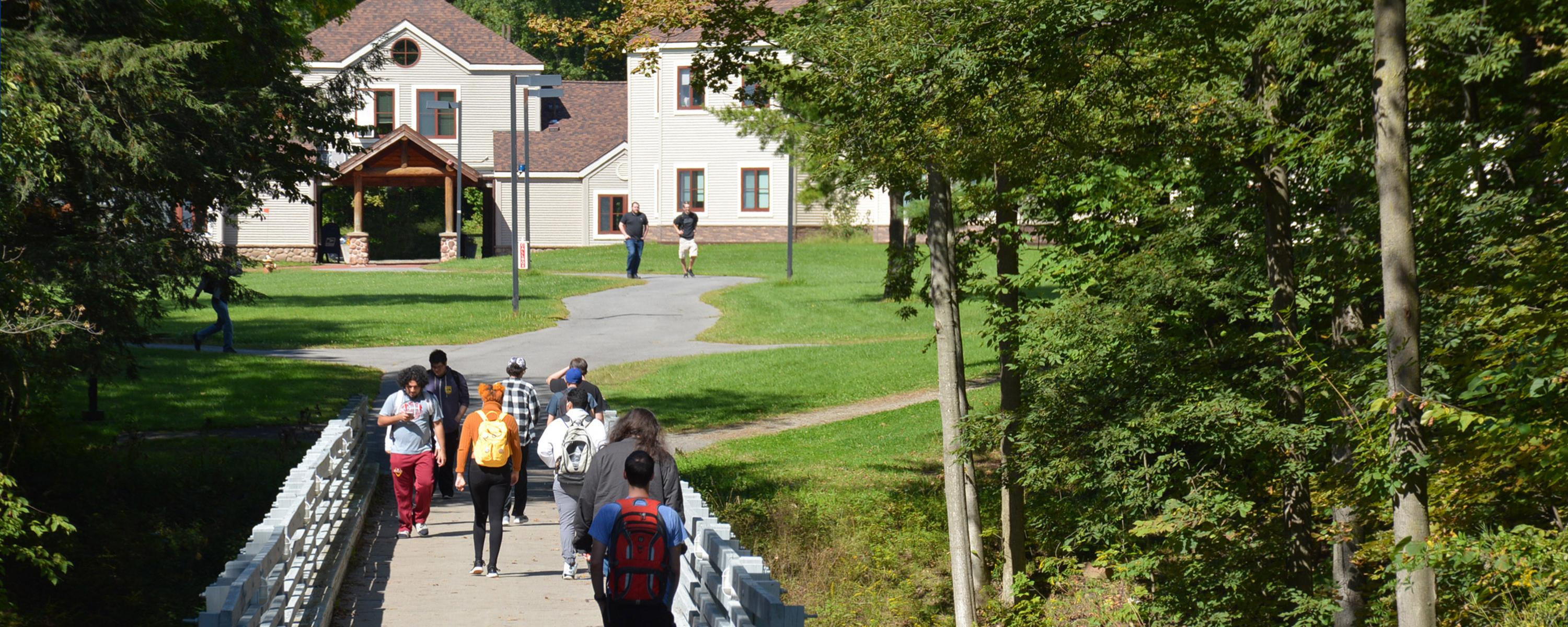 Students walking near Adirondack Residence Hall