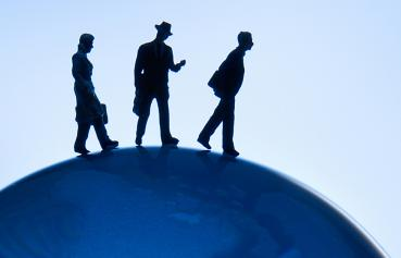 Business Administration - illustrative photo of people walking on globe